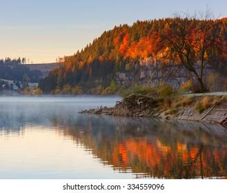 Foggy lake Palcmanska Masa at sunrise with colorful reflection, Dedinky, Narodny park Slovensky Raj (National park Slovak paradise), Slovakia, Eastern Europe - Shutterstock ID 334559096