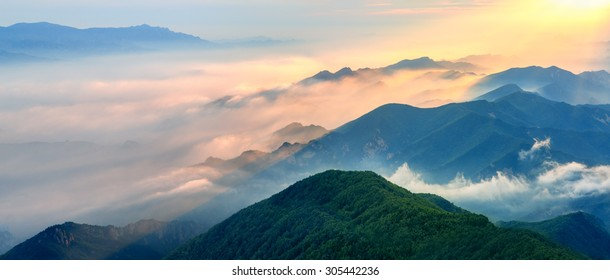 Foggy landscape in the mountains.Fantastic morning glowing by sunlight.