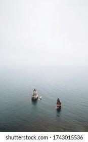 Foggy landscape of rocks and sea
