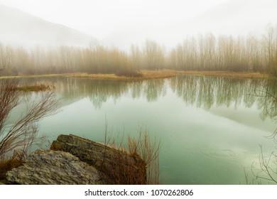 Foggy landscape  within Noguera de Tor river, Barruera, Vall de Boi, Lleida, Catalonia, Spain
