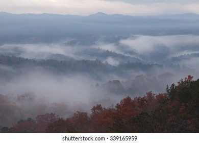 foggy, misty morning landscape in smoky mountains seen from elevation