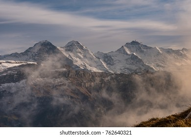foggy mood with iconic swiss alps mountains eiger,mönch and jungfrau in interlaken, bernese oberland