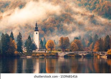 Foggy morning in autumn at Lake Bohinj In National Park Triglav, Slovenia