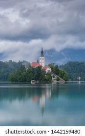 Foggy morning in Bled Slovenia, with Bled island reflecting in Bled lake