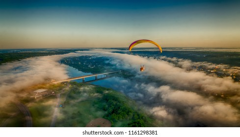 Foggy morning flight over Kaunas. Over foggy river Nemunas.