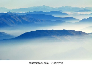foggy morning in italian mountains - mountain range silhouttes