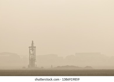 Foggy morning light and pump jack in the Permian Basin