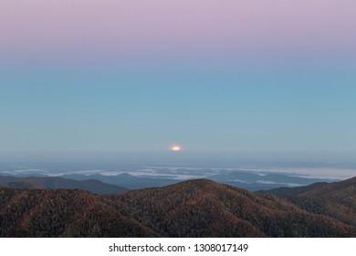 Foggy morning moonset at sunrise over unicoi mountains in North Carolina