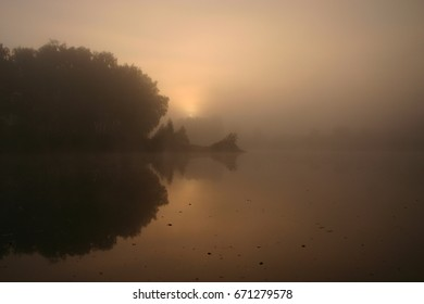 Foggy morning on the lake  - Shutterstock ID 671279578