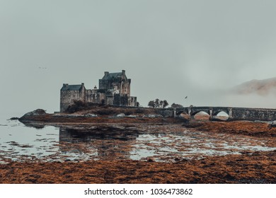 Foggy morning over the Eilean Donan Castle in Scotland, UK