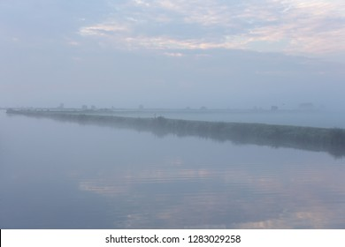 A foggy morning water landscape of the Norremeer of the Kagerplassen in South-Holland The Netherlands.