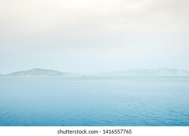 Foggy mountain misty islands covered with fog, calm sea lake landscape background, sunlight in cloudy sky scenery morning weather,