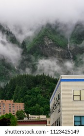 Foggy mountain range in the village of Juneau, Alaska.