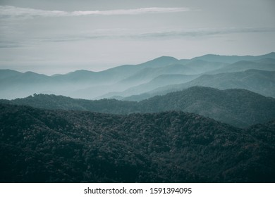 A foggy mountainous scenery under the gloomy sky