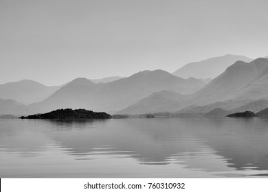 Foggy mountains over the lake