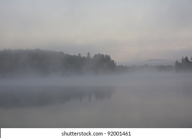 Foggy Muskoka lake at dawn