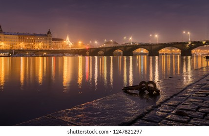 Foggy night over Prague near the Palackeho bridge and vltava river