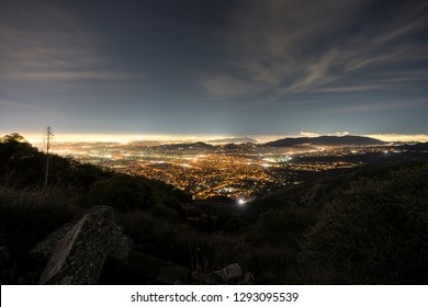 Foggy night view of Pasadena, Glendale and downtown Los Angeles from Echo Mountain in the Angeles National Forest.