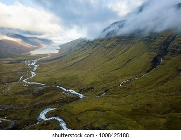 Foggy nordic valley with flowing river, Iceland