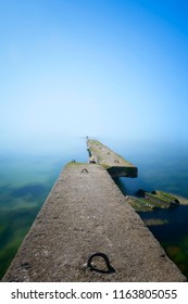 foggy perspective around an old pier