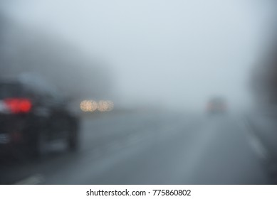 Foggy and poor vision street with blurred cars ahead: Good concept for road safety and drive safely