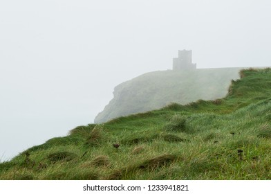 Foggy scene of a stronghold on ocean coastline