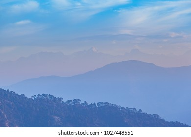 Foggy Sunrise in Himalayan mountains, India, Uttarakhand, Rishikesh.