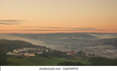 Foggy sunrise over aberystwyth mountains