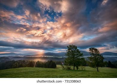 foggy sunrise over the national park Bohemian Switzerland, Czech Republic