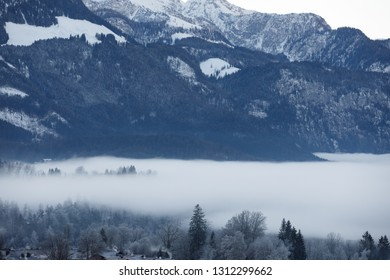 foggy valley in bavarian mountains, alps