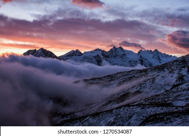 Foggy valley in Gran Paradiso National Park,  Alps, Italy,  dramatic scene, beautiful world. colourful autumn morning,scenic view with cloudy sky, majestic dawn in mountain landscape, wallpaper