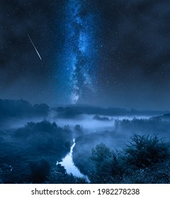 Foggy valley at night with milky way and stars. Wildlife at night in Poland.