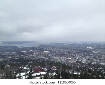 FOggy view on Oslo and its Bay from Holmenkollen Hill on a grey Winter day - Norway