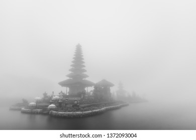 Foggy weather at Pura Ulun Danu Beratan temple in Bali, Indonesia. Black and white photo.