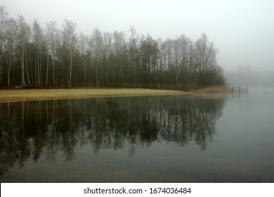 Foggy, wintery images of a lake: the Plas in Rotselaar in Flanders, Belgium. De Plas is an artificial lake created by sand extraction.  Swimming and windsurfing in the summer.