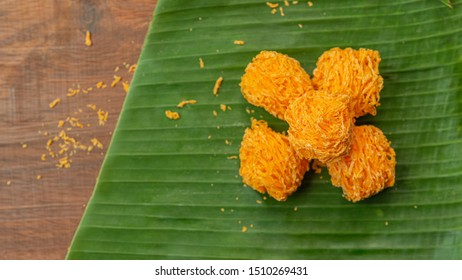 Foi Thong,  (Shredded Egg Yolk Tart) Thai desserts ingredients, used Egg yolks and sugar are boiled in sweet syrup and then formed into hairlike shapes on a banana leaf. Top view.