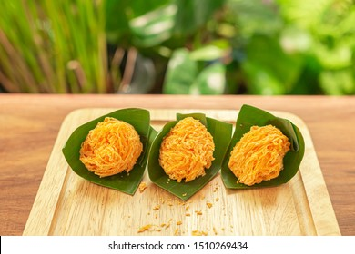 Foi Thong,  (Shredded Egg Yolk Tart) Thai desserts ingredients, used Egg yolks and sugar are boiled in sweet syrup and then formed into hairlike shapes on a banana leaf. Selective focus