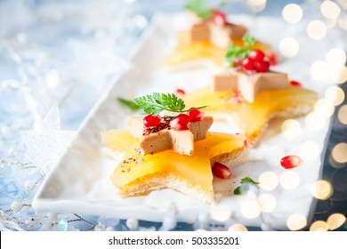 Foie gras and orange aspic on star-shaped toasts