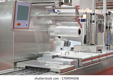 Foil Packing Machine at Production Line in Food Factory