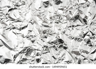 Foil silver crumpled metal aluminum texture background surface decoration backdrop design photo hi resolution