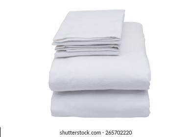 Folded bed linen or duvet cover on white isolated background