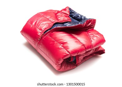 Folded blue and red full zipper windbreaker down jacket, rain proof down jacket. Down jacket sport shiny nylon full zip isolated on white. Folded clothes.
