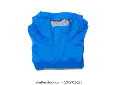 Folded blue zipper windbreaker jacket, rain proof and waterproof hiking Gore-Tex jacket hoodie. Track jacket sport nylon full zip isolated on white. Folded clothes. Outer layer garment for travel.