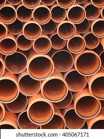 Folded brown industrial tubes circles background