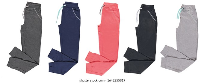 Folded colored jogging pants. Set. Isolated image on a white background.