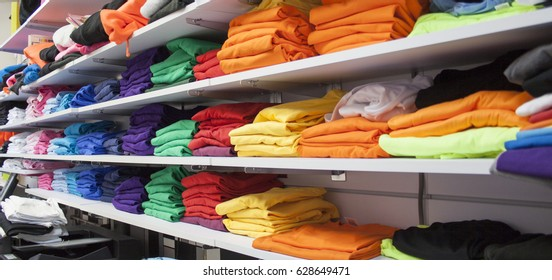 Folded colored tshirts in a shop