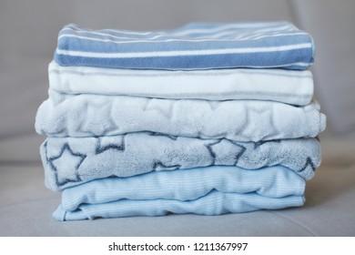 Folded cozy fleece baby boy pajamas. Winter children fashion
