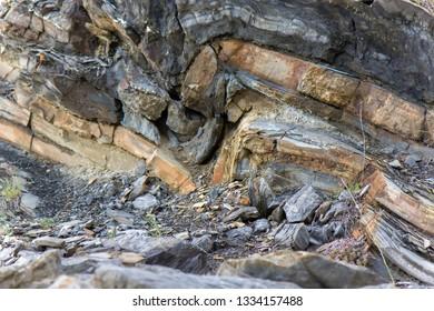 Folded, crumpled, layers of sedimentary rock strata in Zavoj lake, Serbia