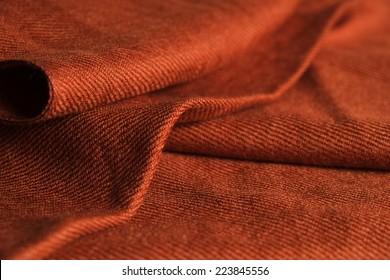 Folded dark orange silk scarf cloth