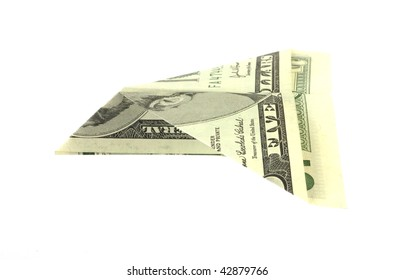 Folded five dollar bill paper airplane